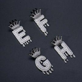 Colgante con Letras Goteando de Plata con Diamantes