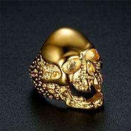 Anillo en forma de Cráneo en Acero de Titanio de Oro